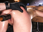 Restrained babe Lilly Lit squirts all over the place in the dark BDSM room
