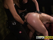 Two mistresses ties up and fuck sex-appeal hooker Kimber Woods in the dark BDSM room