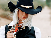 Gorgeous blond cowgirl Emma Hixgets her pussy nailed on the prairie