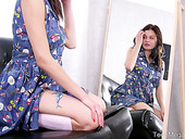 Modest teen Odell is toying her smooth beautiful pussy in front of the mirror