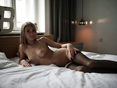 Sexually charged babe in stockings Nancy Ace is masturbating pussy early in the morning