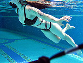 Belorussian swimmer Sheril Blossom shows striptease under the water