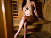 Juggy Milf Tindra Frost Shows Off Her Captivating Boobs In The Sauna