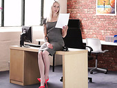 Slender secretary Ashleigh Doll is reading erotic stories in the office