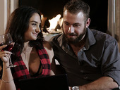 Voluptuous brunette Sheena Ryder is making love by the fireplace
