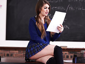 Salacious student in short skirt Katie Louise is reading erotic stories