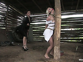 Angry brunette puts on strapon and fucks tied up blond hooker Erika Angel