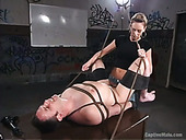 Cruel domina Audrey Leigh strapon fuck anal hole of man with tied up balls