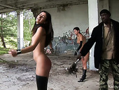 Two sexy nude babes are punished by one kinky dude in an abandoned building