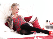 Sassy tattooed bitch Becky Holt gets naked and tells erotic stories