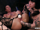 Tattooed mistress Charlotte Sartre is fisting girlfriend's anal hole