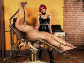 Kinky mistress in latex corset Goddess Starla is punishing one submissive bitch