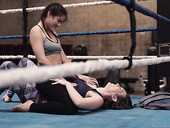 Two boxing babes are strapon fuck each others pussies in the ring