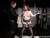 Chubby woman in stockings and garters Kitty is punished with clothes pins