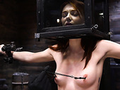 Ginger babe Lacy Lennon is tied up and punished in the dark basement