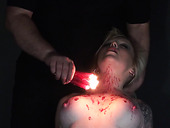 Dirty bitch Angel is tied up and punished with hot candle wax in the dark BDSM room
