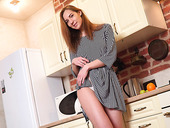 Adorable red haired coquette Milana M is masturbating on the kitchen table