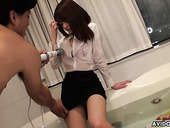 Clothed Asian babe Kimoko Tsuji gets her pussy toyed in the bathtub