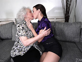 Young lesbian Tiffany Doll is licking pussy of good looking granny