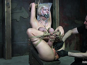 Tied up blond bitch Cherry Torn gets her pussy toyed in the basement