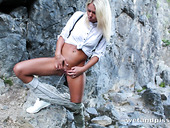 Beautiful girl Claudia Macc is pissing and masturbating pussy in the rocky mountains