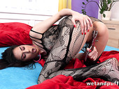 Whorish babe in body fishnets Ashley Ocean is dildo fucking puffy snatch