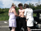 Two chubby mature women bang young student on the road