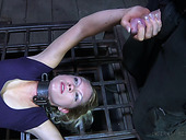 Restrained mature blonde Rain DeGrey is humiliated and punished in the dark BDSM room