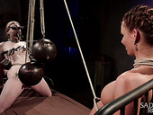Two babes are tied up and punished by one kinky man
