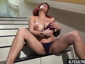 Gorgeous red head Alyssa Lynn is jilling off snatch on the stairs