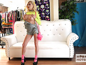 Young blonde Carolina Sweets shows yummy tushy and perky ninnies