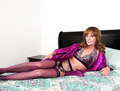 Red haired woman over 50 Cyndi Sinclair is dildo fucking stretched pussy