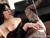 Amateur chick in crotchless body fishnet masturbates pussy and pisses