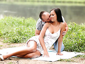 Honeymooners are making love by the lake in broad day light