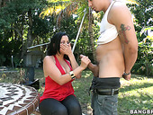 Busty brunette Diamond Kitty sucks a stiff cock in the park