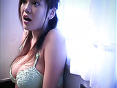 Japanese babe Yoko Matsugane is posing on web cam showing off her big boobs