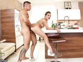 Impressively hot mature slut Szilvia Lauren rides a cock in the kitchen
