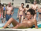 Busty nude babe  spied upon on Barcelona beach