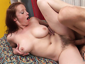Busty European milf rides a hard cock with her hairy cunt
