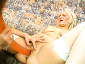 Two feisty grannies Francesca and Erlene are fucking passionately using a huge dildo