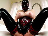 Sextractive domina fully covered with latex tickles her aroused pussy