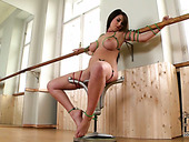 Hot and sexy brunette milf is tied to the chair and pees