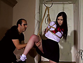 Kinky girl is hogtied and hanged down the ceiling