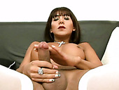 Ladyboy Loly jerks her shlong and  rolls eyes with pleasure