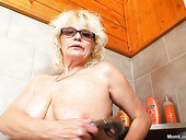 Two lesbian grannies masturbate with shower head
