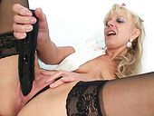 Tasty looking granny Anezka drills her twat with huge dildo