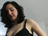 Sexy brunette denudes her tits and gets on her knees to blow a cock