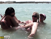 Two rapacious lesbians tickle pinkish clit of another hussy