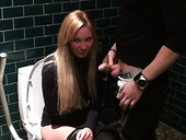 Busty blondie Lindsey gives a blowjob while sitting on toilet bowl