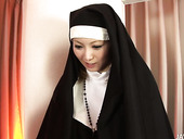 Titless nun from Japan gets her fluffy pussy drilled from behind tough